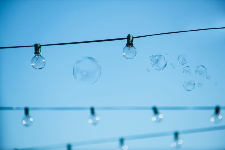 Low angle view of bubbles against clear sky