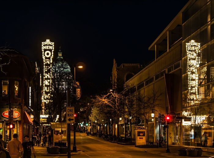MADISON, WISCONSIN - MAY 07, 2018: Downtown with the New Orpheum venue sight lit up. Sign Lights Relection University Madison State Capitol Building State Street New Orpheum Wisconsin Nightlife Night Building Exterior Illuminated Built Structure Architecture City Street Street Light