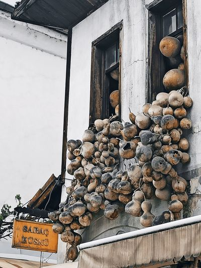 Stack of logs by building