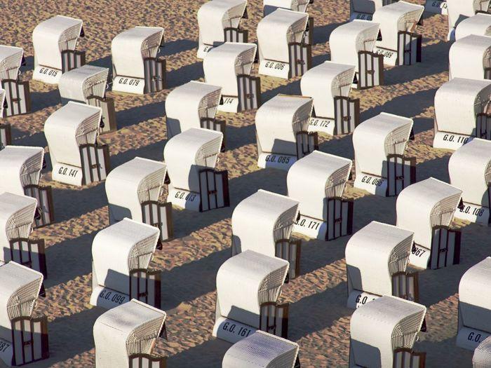 Full frame shot of hooded beach chairs