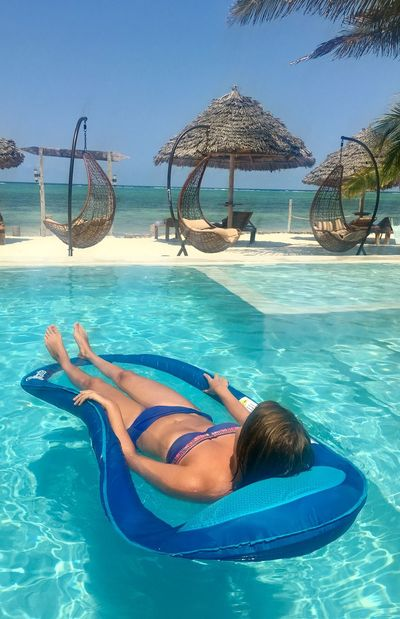 Relaxing Sunshine Day Zanzibar Zanzibar_Tanzania Zanzibarisland Africa Inflatable  Leisure Activity Leisure Time One Person Pool Pooltime Real People Relaxation Swimming Pool Turquoise Colored Vacations Young Women
