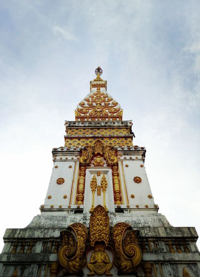 Low angle view of replica phra that phanom  against sky