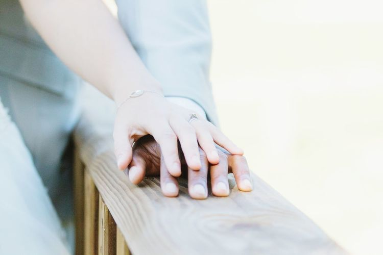 Cropped image of couple on railing