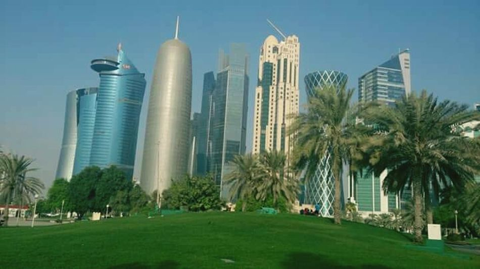 Modern City Building Exterior Skyscraper Architecture Urban Skyline Lawn Cityscape Grass Business No People Built Structure Clear Sky Outdoors Downtown District Day CORNICHE DOHA Qatar Days