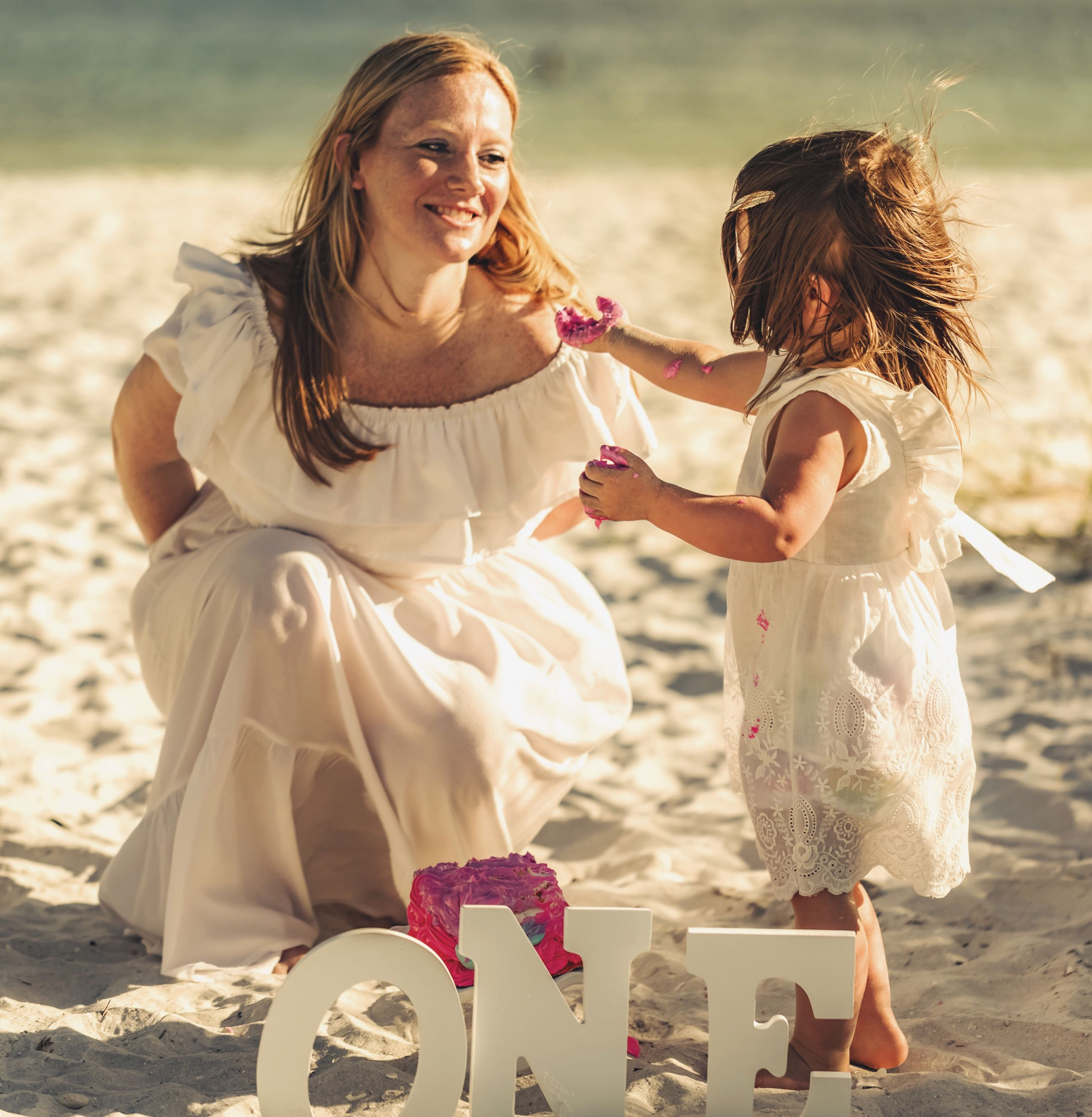 two people, land, real people, women, togetherness, leisure activity, lifestyles, beach, females, nature, adult, emotion, girls, sunlight, child, love, bonding, young women, people, positive emotion, hairstyle, outdoors