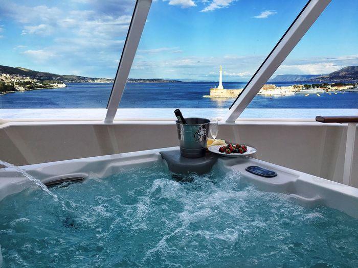Sea seen through window by bathtub in boat