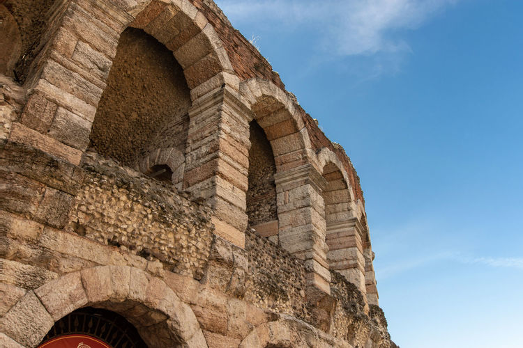 a wonderful blue sky over the arena in verona Verona Amphitheater Ancient Ancient Civilization Ancient History Arch Archaeology Architecture Building Exterior Built Structure Day Europe History Italy Low Angle View Old Old Ruin Outdoors Roman Sky Stone Wall The Past Tourism Travel Travel Destinations