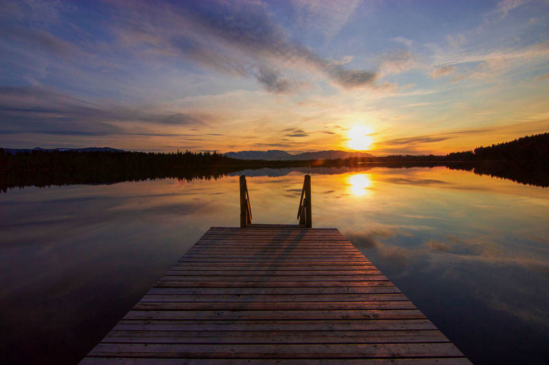 Jetty Over Lake Against Sky During Sunset