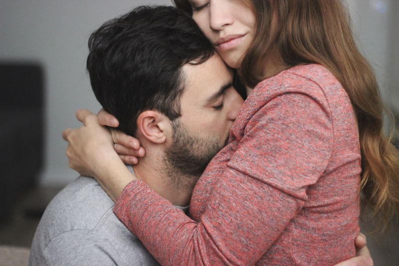 Two People Love Togetherness Couple - Relationship Young Adult Heterosexual Couple Embracing Emotion Women Young Women Young Men Affectionate Eyes Closed  Positive Emotion Men Bonding Beard Indoors  Young Couple Adult Focus On The Story This Is My Skin