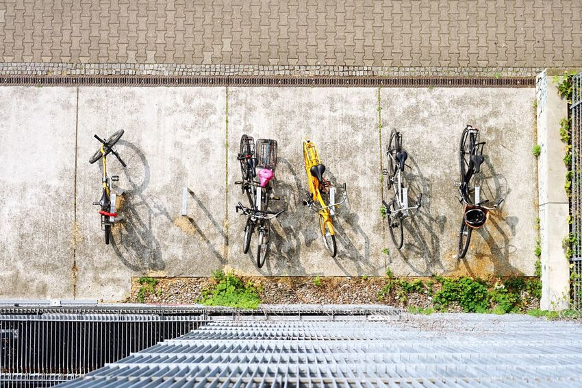 Bicycles Cycling Day No People Creativity Wall - Building Feature Outdoors Architecture Built Structure Transportation Sunlight Street City High Angle View Road