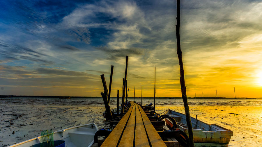 Jetty sunset, wooden Pier on the sea Beautifull Beauty In Nature Bridge Cloud - Sky Day Horizon Over Water Jetty Jetty, Pier Mode Of Transport Nature Nautical Vessel No People Orange Color Outdoors Scenery Scenics Sea Sky Sunrise Sunset Sunsets Tranquility Transportation Water Yellow