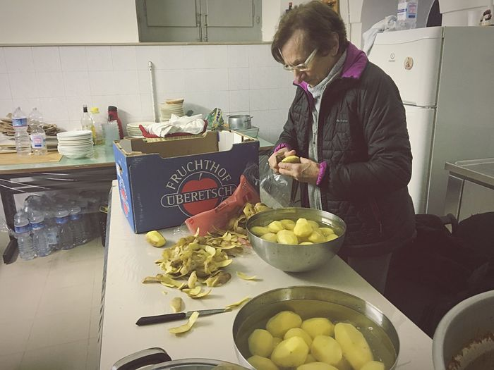 Food Indoors  Real People One Person Food And Drink Healthy Eating Preparation  Kitchen Fruit Freshness Young Adult Old Woman Cooking Day Adult People