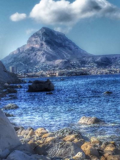 Mountain Water Tranquil Scene Scenics Rock - Object Sea Tranquility Beauty In Nature Nature Sky Shore Sandies Seascape Seascape Seascape Photography Mountains Mountains And Sky Pebble Mountain Range Blue Cloud - Sky Majestic Day Outdoors Calm