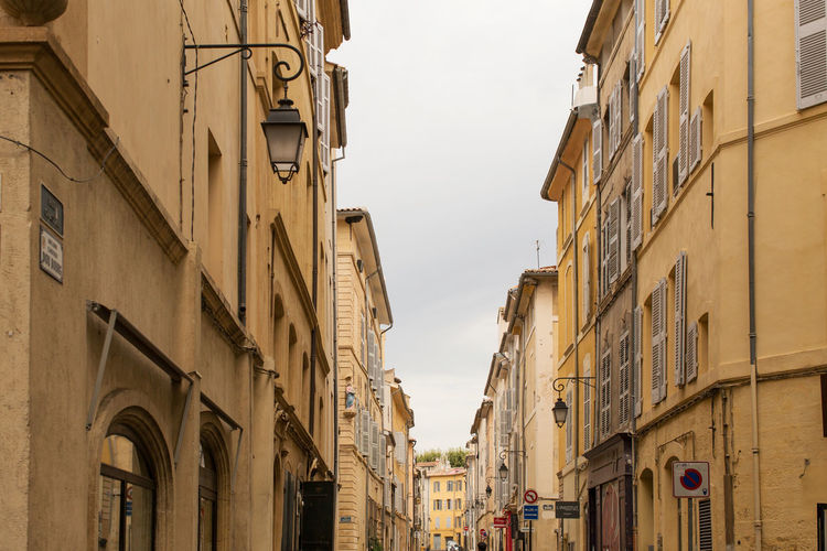 A narrow street at the Old city, Aix-en-Provence Architecture Building Exterior Built Structure City Day High Section Low Angle View No People Old Town Outdoors Residential Building Residential District Sky Window