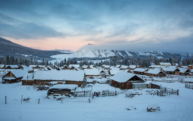 Winter Cold Temperature Snow Sky Mountain Scenics - Nature Cloud - Sky Beauty In Nature Covering Architecture Environment Built Structure Tranquility Tranquil Scene Building Exterior White Color Nature Landscape Building No People Snowcapped Mountain Mountain Range Outdoors Hemu Village Sunrise XinJiang China