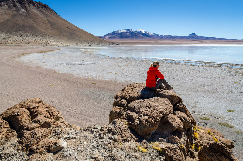Woman on the bolivian flats Beauty In Nature Bolivia Flat Mountain Nature One Person Real People Rock - Object Scenics Woman Women