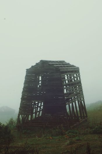 Fog Old Ruin Abandoned No People Built Structure Spooky Outdoors History Architecture Grass Building Exterior Travel Destinations Day Sky Nature Tranquility Grass Architecture Scenics Residential Building