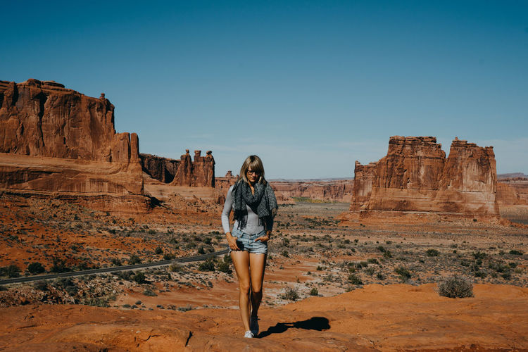 Full length of woman standing at monument valley