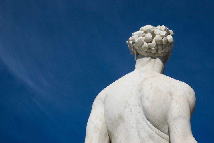 Low angle view of statue against blue sky in rome italy