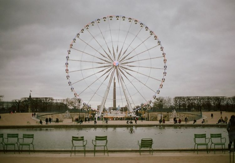 Paris, January 2018. EyeEmNewHere Film Photography Analogue Photography 35mm Film 35mm Winter Europe Paris Amusement Park Ferris Wheel Arts Culture And Entertainment Sky Built Structure Big Wheel Day Water Architecture Building Exterior EyeEmNewHere