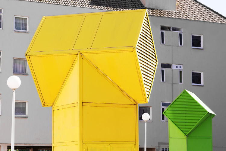 air conditioner and ventilation with decorating outdoor ducts Air Conditioner Air Ventilation Aire Libre Ventilation Built Structure Architecture Yellow No People Outdoors Multi Colored Green Color Cooling  Mechanism Circulation Enginer Industrial Industrial Equipment Steel