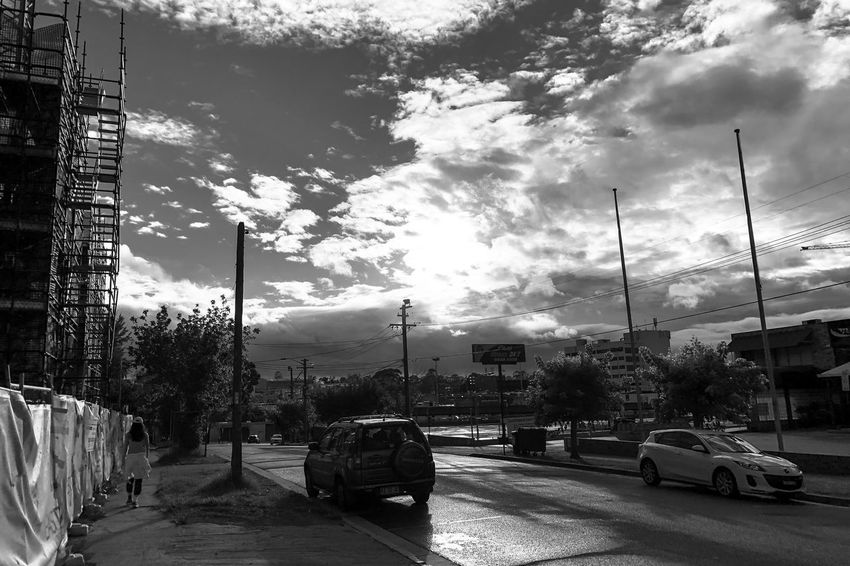 The sun also rises Light And Shadow Monochrome Black And White Car Transportation Land Vehicle Cloud - Sky Sky Building Exterior Mode Of Transport Architecture Tree Road Outdoors Day Built Structure