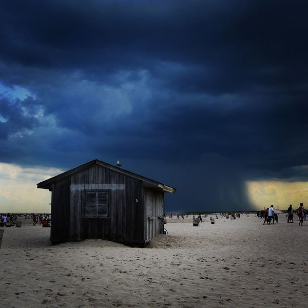 Jones Beach Impending Storm Dark And Stormy Beach Beauty In Nature Bird Darkness And Light Impending Doom  Impending Rain Impending Storm Nature Sand Seagull Shack Sky Storm Cloud