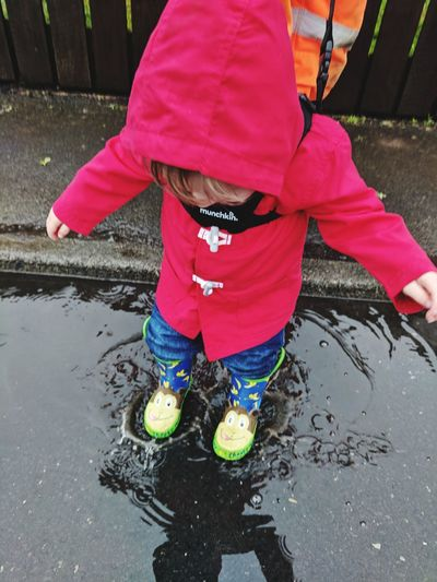 It's the little things.. County Durham Consett Puddle Splash Splashing Jumping Happiness Love 1yearold Redcoat Wellies  Life Outdoors Outdoor Photography Low Section Child Childhood Water Puddle Rain RainDrop Wet Drop Water Drop Rubber Boot Footwear Shoe Rainy Season Raincoat Rainfall