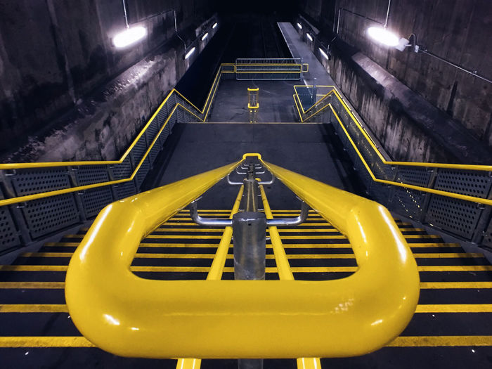 High Angle View Of Empty Yellow Steps In Underground Subway Station