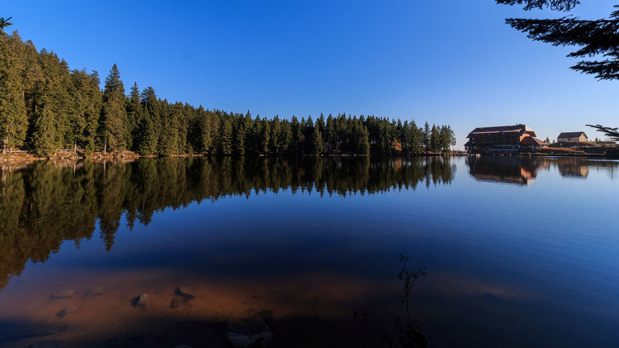 Mummelsee im Herbst Schwarzwald Architecture Beauty In Nature Black Forest Clear Sky Day Forest Lake Nature No People Outdoors Reflection Scenics Sky Tranquility Tree Water