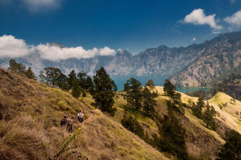 People walking to segara anak lake rinjani mountain