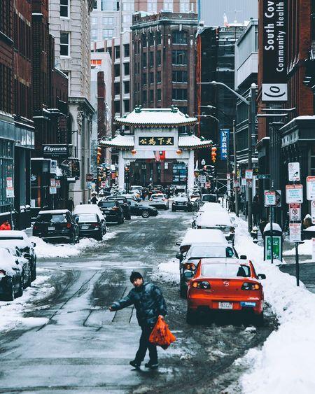 Boy on city street during winter