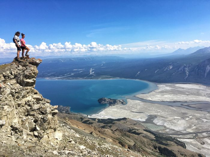 Sheep Mountain cliff Kluane Lake Alaska Hiking Couple Hiking Cliff Viewpoint Water Sea Beauty In Nature Real People Scenics - Nature Nature Lifestyles
