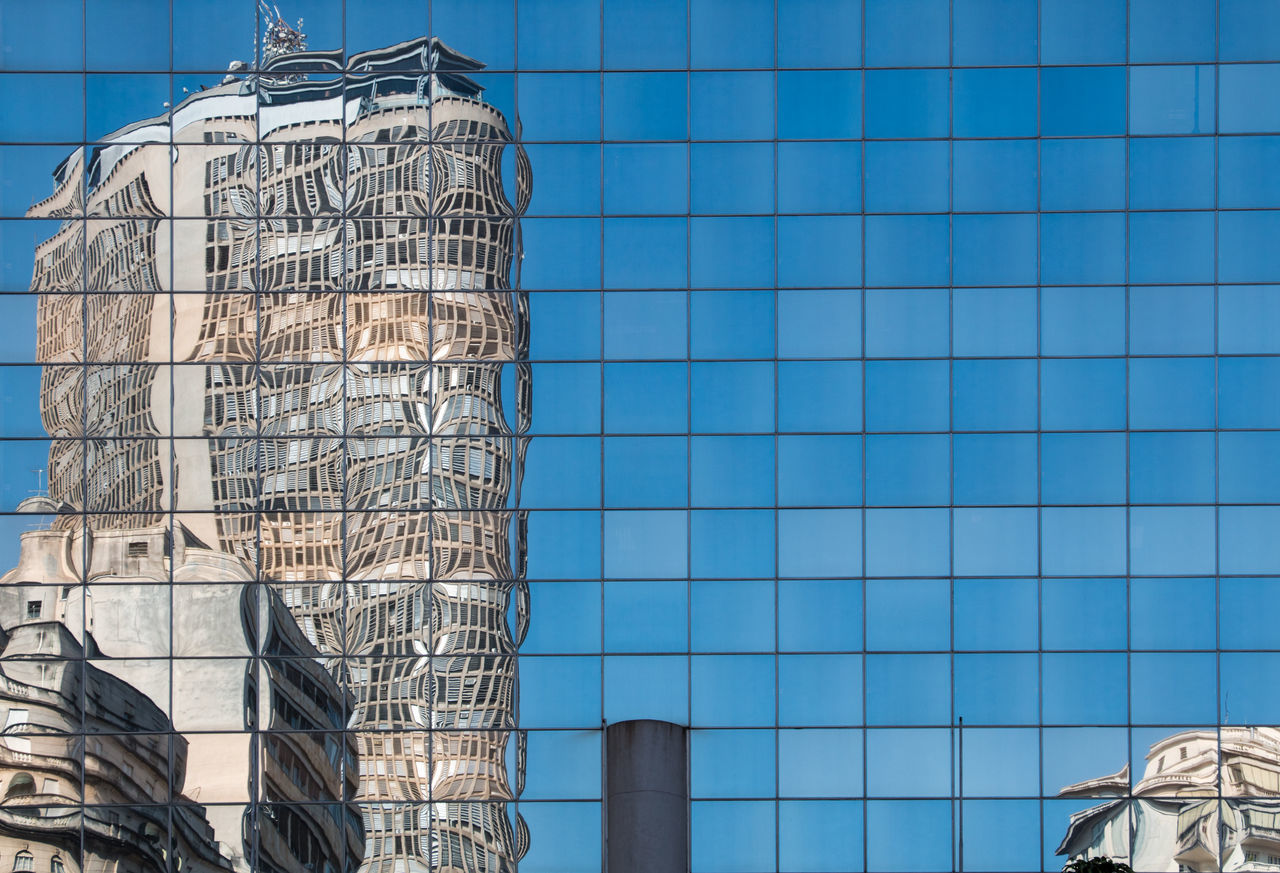 Full Frame Shot Of Modern Glass Building With Skyscraper Reflection