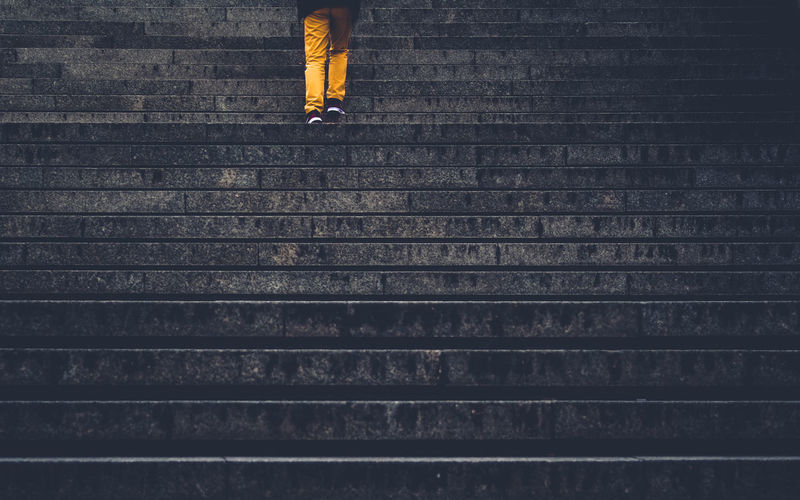 Low Section Of Woman Walking On Staircase