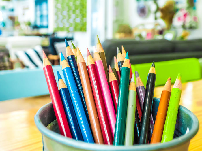 Multicolored pencils are combined in a steel box on a desk in the office. Art Background Blue Bright Brown Closeup College Color Colored Colorful Colors Colour Concept Crayon Crayons Creative Design Draw Drawing Education Equipment Frame Green Group Image Isolated Macro Object Office Orange Paint Palette Pen Pencil Pencils Rainbow Red Row School Set Sharp Stationery Supplies Up Variation Vector White Wood Wooden Yellow Multi Colored Writing Instrument Large Group Of Objects Close-up Still Life Focus On Foreground No People Choice Art And Craft Indoors  Colored Pencil Creativity Craft Table Art And Craft Equipment Selective Focus Vibrant Color Day