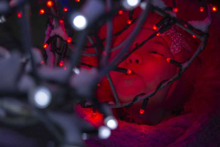 One Person Portrait Headshot Red Selective Focus Celebration Illuminated Christmas Looking Night Young Adult Child Decoration Close-up Childhood Looking Away Holiday Christmas Decoration Contemplation Innocence Girl Portrait Cute View Emotions Red Lights
