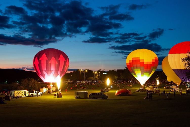 Balloon Glow Illuminated Night Sky Large Group Of People Outdoors Multi Colored Hot Air Balloon Ballooning Festival EyeEm Best Shots Eye For Photography Dark Photography EyeEm Gallery Lifestyles Sunset