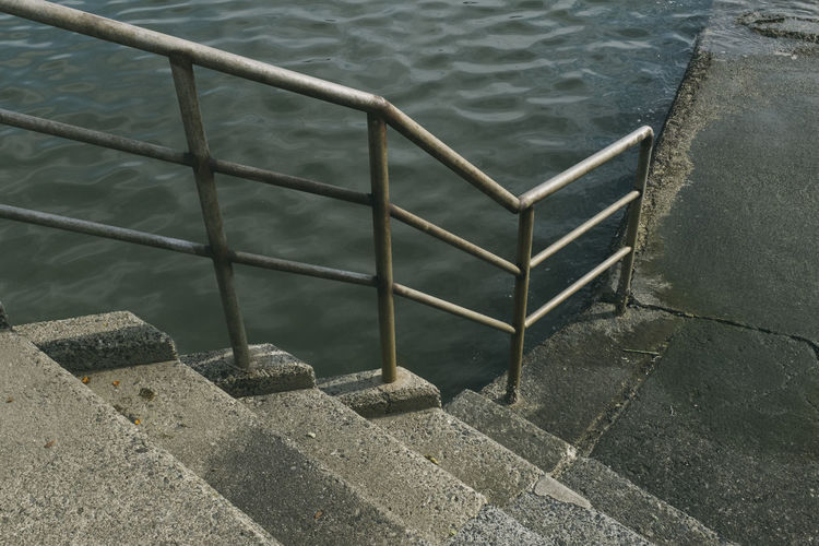 Nature Day No People Outdoors Water High Angle View Staircase Railing Architecture Metal Steps And Staircases Built Structure Lake Pattern Security Concrete Ladder Wall - Building Feature