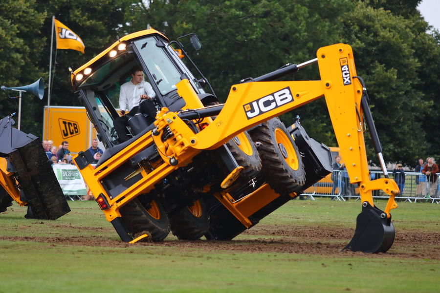 Dancing JCB Ashbourne Dancing England, UK Event JCB Show Colorful Digger Yellow Color