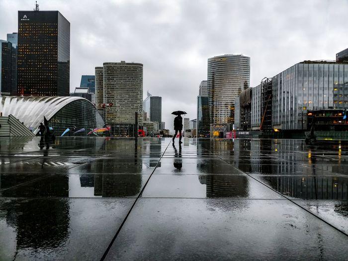Modern buildings against sky during rainy season