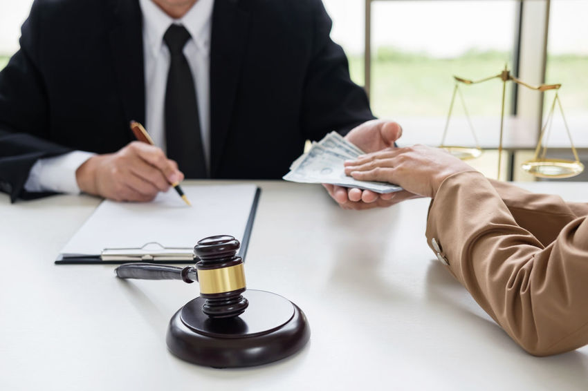 Banknotes Bribe Lawyer Agreement Barrister Business Business Person Businessman Contract Corruption Fairness Formalwear Gavel Giving Holding Human Hand Indoors  Judgement Men Midsection Money Occupation People Well-dressed Writing