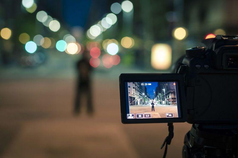 Close-up of digital camera at night