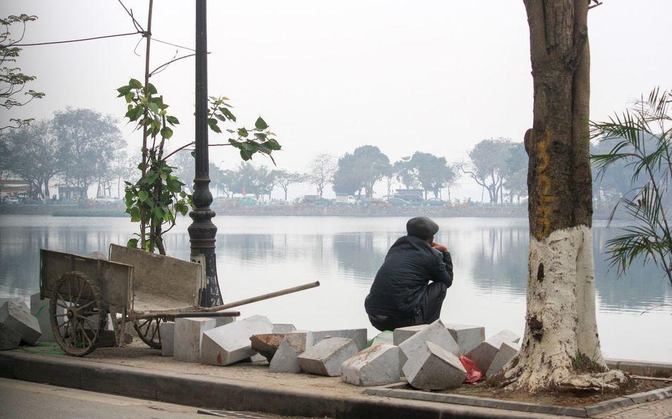 Taking A Break Having A Break Truc Bach Lake Street Light Wheel Barrow Under The Streetlight Works Done Hanoi, Vietnam Street Photography Side Of The Road Truc Bach Lake, Hanoi Vietnam