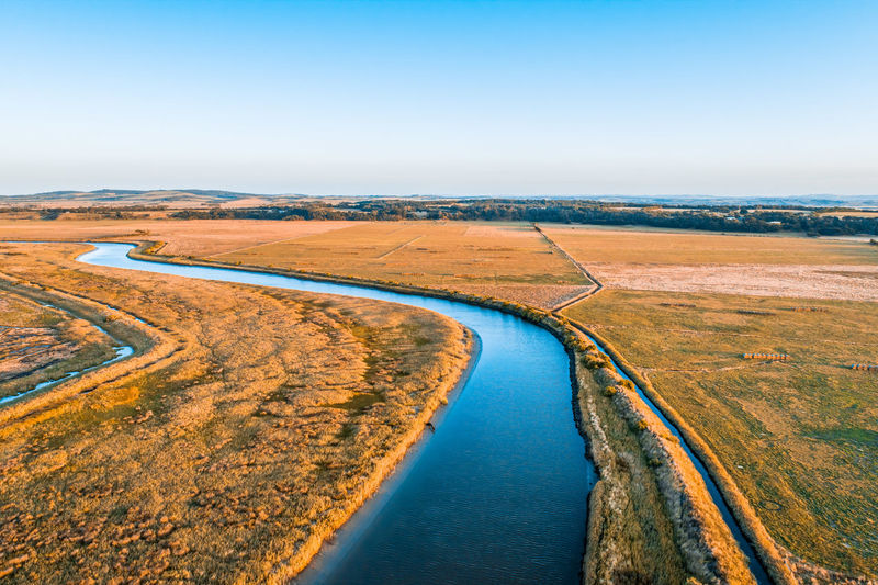 Scenic aerial view of river flowing through australian countryside
