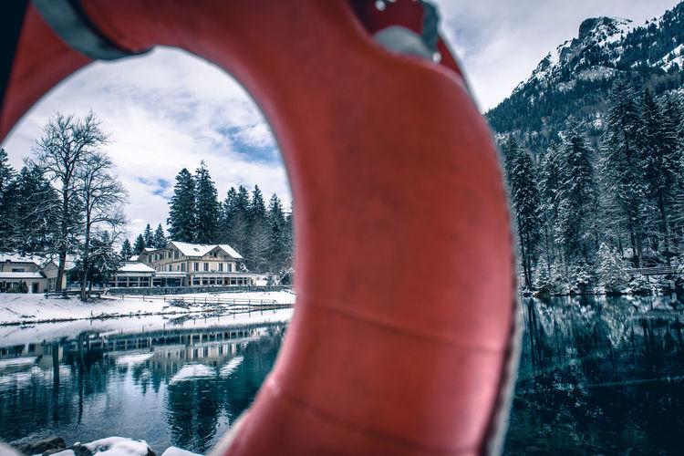 Close-up of lake seen through life belt during winter