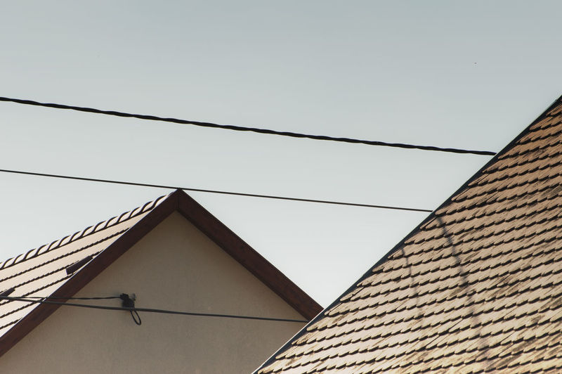 roof. Architecture Blue Sky Bricks Building Exterior Built Structure Cable Cables City Clear Sky Day Gradient House Houses Low Angle View No People Outdoors Reflect Reflection Roof Roofs Shadow Shadows & Lights Sky Urban Urban Picture