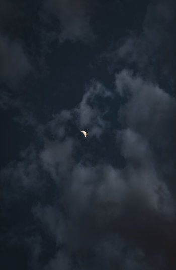 Sky Cloud - Sky Low Angle View No People Beauty In Nature Moon Night Nature Scenics - Nature Outdoors Tranquility Crescent Space Overcast Tranquil Scene Dark Solar Eclipse Smoke - Physical Structure Astronomy Eclipse Ominous Planetary Moon Meteorology