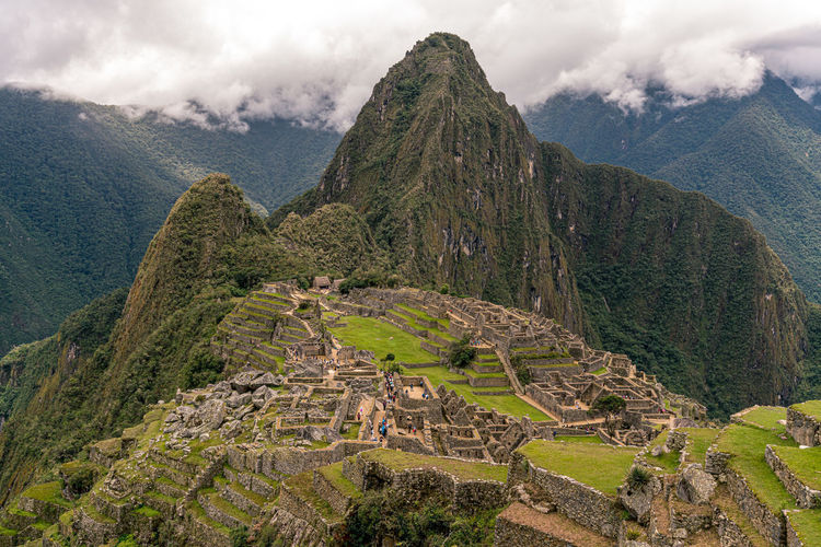 scenic view of machu picchu and  mountains against cloudy sky