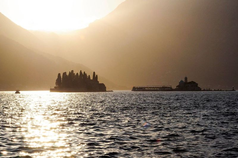 Montenegro PERAST Our Lady Of The Rocks Sunset Mediterranean  Water Nature Sun Waterfront Beauty In Nature Nautical Vessel Mountain Scenics Silhouette Transportation Tranquility Sea Outdoors No People Sunlight Tranquil Scene Architecture Sky Building Exterior